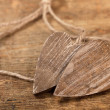Tied wooned hearts on old  wood - Stock Photo