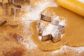 Christmas gingerbread tree cookie cutter on dough with rolling p — Stock Photo