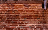 Centuries-old brick wall — Stock Photo