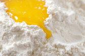 Bake it! egg yolk on white flour — Stock Photo