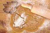 Christmas gingerbread tree cookies with cutter , dough and rolli — Stock Photo
