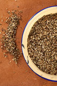 Zaatar- a blend of herbs, sesame seeds and salt in an old ename — Stock Photo