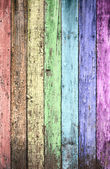 Aged rainbow painted wooden fence, naturally weathered — Stock Photo