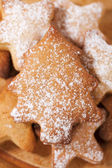 Homemade christmas gingerbread tree cookie on stars, dusted — Stock Photo