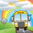 Vector yellow school bus on the road — Imagens vectoriais em stock