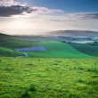 Beautiful English countryside landscape over rolling hills — Stock Photo #11169178