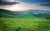 Beautiful English countryside landscape over rolling hills — Stock Photo