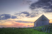 Old barn in landscape at sunset — Stock Photo