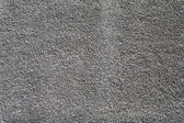 Wall covered with large granite sand. — Stock Photo