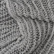 Close up grey knitted pullover background — Stock Photo #11576332