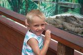 Little boy on crocodile farm — Stock Photo