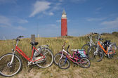 Five family bicycles against a classical red beacon — Stock Photo