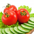 Tomatoes and cucumber with lettuce — Stock Photo