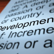 Development Definition Closeup Showing Improvement - Stock Photo