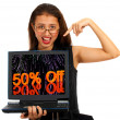 Girl With Fifty Percent Off Screen Showing Sale Discount Of Fifty Percent — Stock Photo #11105478