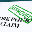 Stock Photo: Work Injury Claim Approved Shows Medical Expenses Repaid