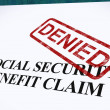 Stock Photo: Social Security Claim Denied Stamp Shows Social Unemployment Ben