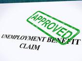 świadczeń z tytułu bezrobocia twierdzą, zatwierdzoną pieczęcią pokazuje zabezpieczenia społecznego — Zdjęcie stockowe