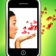 Girl Blowing Hearts From A Mobile Phone — Stock Photo