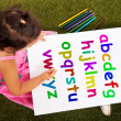 Girl Writing Alphabet Shows Kid Learning — Stock Photo #11843403
