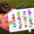 Girl Writing Alphabet Shows Kid Learning — Stock Photo