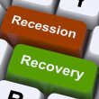 Stock Photo: Recession And Recovery Keys Show Upturn Or Downturn