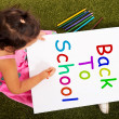 Girl Writing Back To School As Symbol For Education — Stock Photo