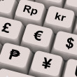 Stock Photo: Currency Symbols On Computer Keys Showing Exchange Rates