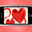 Foto de Stock  : Red Hearts On Mobile Show Love And Romance