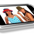 Stock Photo: Two Teenage Friends In Hats Picture On Smartphone