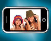 Two Teenage Girls In Hats Picture On Smartphone — Stock Photo