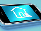House Symbol On Mobile Screen Shows Real Estate Or Rentals — Stock Photo