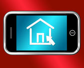 House Symbol On Mobile Shows Real Estate Or Rentals — Stock Photo