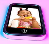Girl With Toys Picture On Mobile Phone — Stock Photo