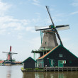 Windmill near the river at Zaanse Schance, Holland - Stock Photo