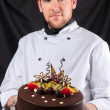 Stock Photo: Handsome chef with cake