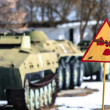 Radiation hazard sign with tanks - Foto de Stock