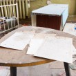 Stock Photo: Old documents on dirty table