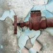 Stock Photo: Rusty old tap against concrete wall