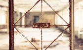 Vintage broken window with blurry corridor — Stockfoto