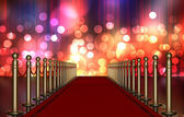 Red carpet entrance with Multi Colored Light Burst — Stock Photo