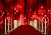 Röda mattan entré med rött ljus burst över gardin — Stockfoto