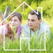 Young couple dreaming to a house — Stock Photo