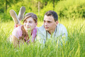 Young couple lying in park — Stock Photo