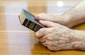 Holding the bible — Stock Photo