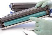 Hands repairing toner cartridge — Stock Photo