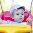 Baby boy swinging — Stock Photo