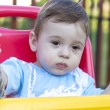 Baby boy in swing — Stock Photo