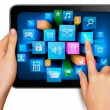 Hand holding touch pad pc and finger touching it s screen with icons - Image vectorielle