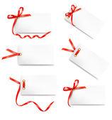 Kartı dekontlarının şeritler kırmızı hediye yay ile ayarla — Stok Vektör
